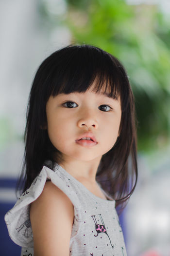 Bangs Black Hair Child Childhood Close-up Contemplation Cute Females Focus On Foreground Front View Girls Hair Hairstyle Headshot Innocence Looking At Camera One Person Portrait Real People Women