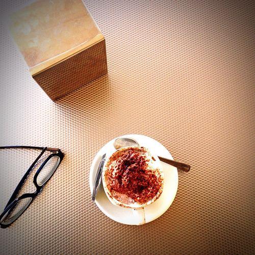 High angle view of coffee and eyeglasses on table