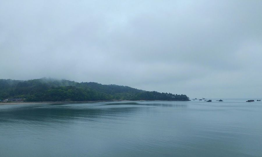 Nature Water Sea Beauty In Nature Outdoors No People Landscape Tree Sky Mountain Day Swimming Rainy Foggy Day Misty Landscape Island Hazy Day An island in the rain
