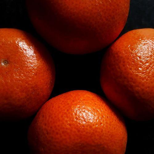 Close-up of oranges over black background