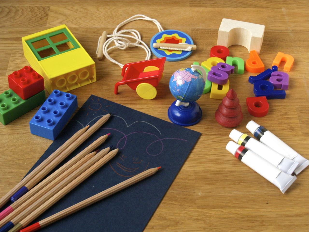 High Angle View Of Toys On Hardwood Floor
