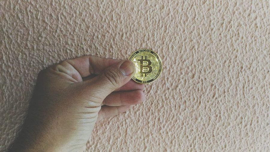 Cryptocurrency Bitcoin Cryptocurrency Bitcoin Holding Digital Currency Day Copy Space negative space Human Hand Human Finger Close-up Personal Perspective
