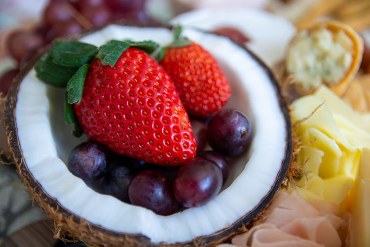 Close-up of grapes and strawberries in coconut