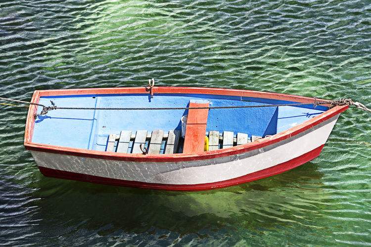old fisherman boat at sunny day moored in harbor , fishing rowboat Fishing Boat Moored Nautical Vessel Wooden Hook SurfCasting Rowing Fish Traditional Background Harbor Fishing Sea Pier Port Catch Rowboat Fisherman Boat