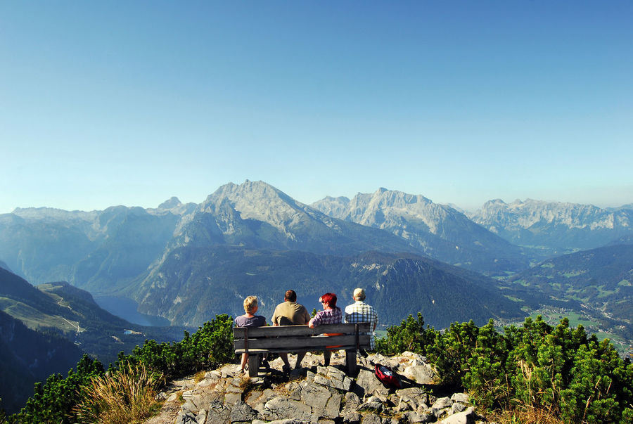 Kehlsteinhaus (Eagle's Nest) Adult Beauty In Nature Copy Space Day Group Of People Holiday Leisure Activity Lifestyles Looking At View Men Mountain Mountain Range Nature Outdoors People Real People Scenics - Nature Sitting Sky Travel Vacations Women
