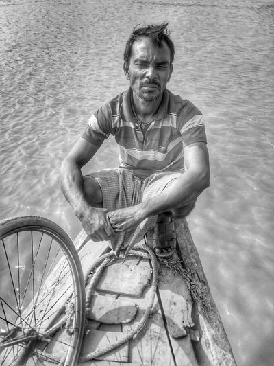 Portrait Smiling Happiness Men Looking At Camera Bicycle Water Old-fashioned Retro Styled Cheerful