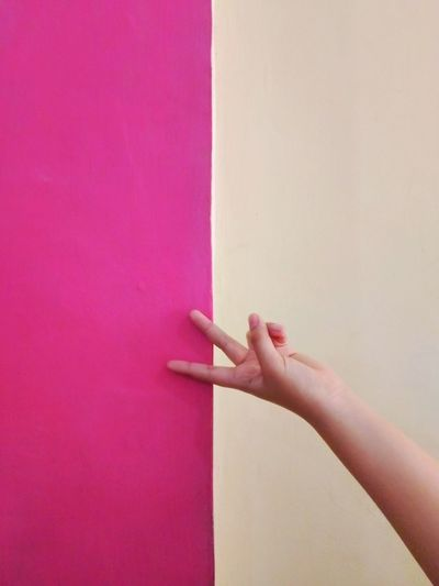 Cropped Hand Of Woman Gesturing Over Colorful Paper