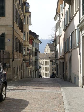 Alley Architecture Building Building Exterior Built Structure City City Life Old Town Fassade Zurich, Switzerland Zürich Zürich My City Cobblestone Day Diminishing Perspective Incidental People Residential Building Residential Structure Historical Building Spring Street Streetphotography Urban Spring Fever Grossmünster The Architect - 2016 EyeEm Awards