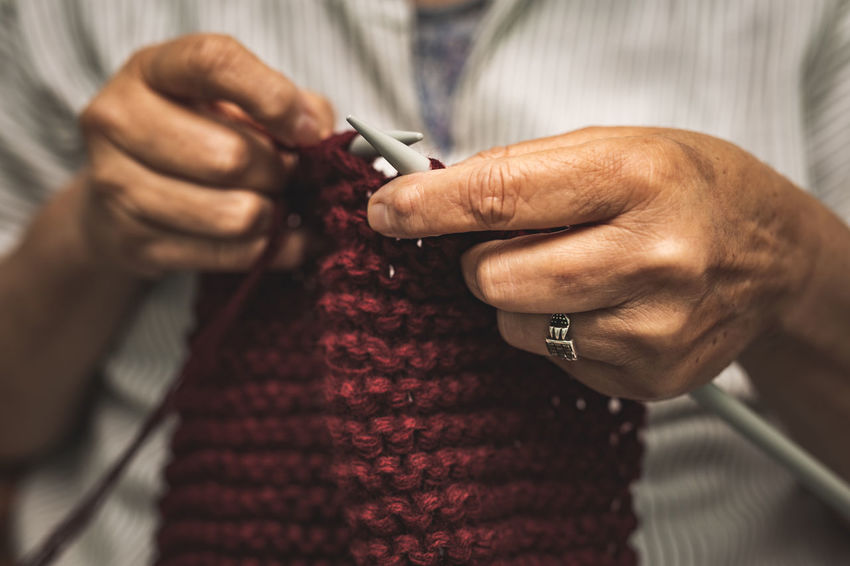 close up of old woman's hands knitting Finger Real People Textile Knitting Needle Skill  Focus On Foreground Wool Creativity Adult Senior Adult Craft Holding Close-up Art And Craft Indoors  Human Body Part Midsection One Person Hand Human Hand Indoors  Skill  Knitting Senior Women