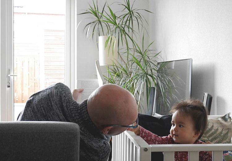 Close-up of father and daughter at home