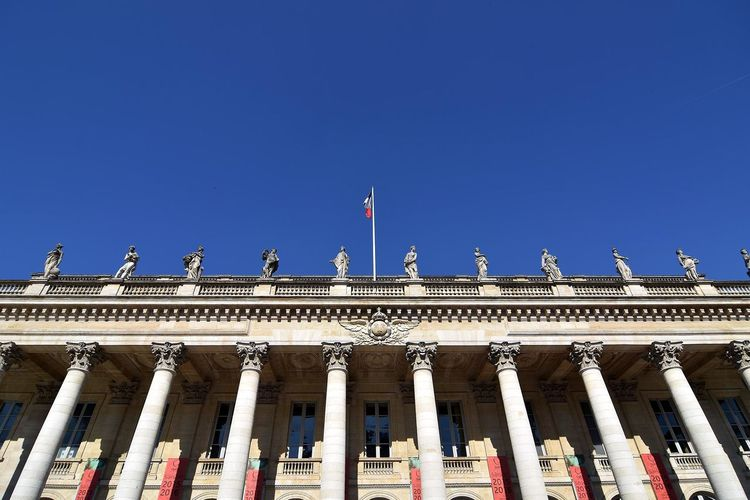 Low angle view of sculptures on grand theater de bordeaux against clear sky