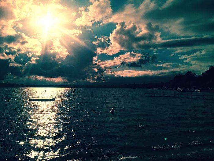 Outside Elizabeth Lake, Michigan Lake Water Till The Sun Goes Down Sunset Sky Scenics Tranquil Scene Wave Beach Cloud - Sky Blue Raft