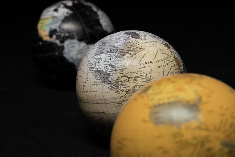 Antique Astronomy Black Background Close-up Globe - Man Made Object Indoors  Map No People Old-fashioned Physical Geography Planet - Space Planet Earth Science Single Object Space Sphere Still Life Studio Shot Travel