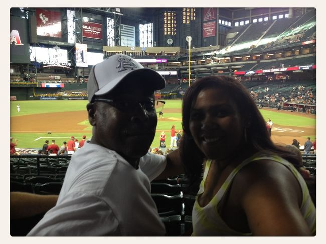 Chelsea and PapaTyler enjoying the D Backs game.