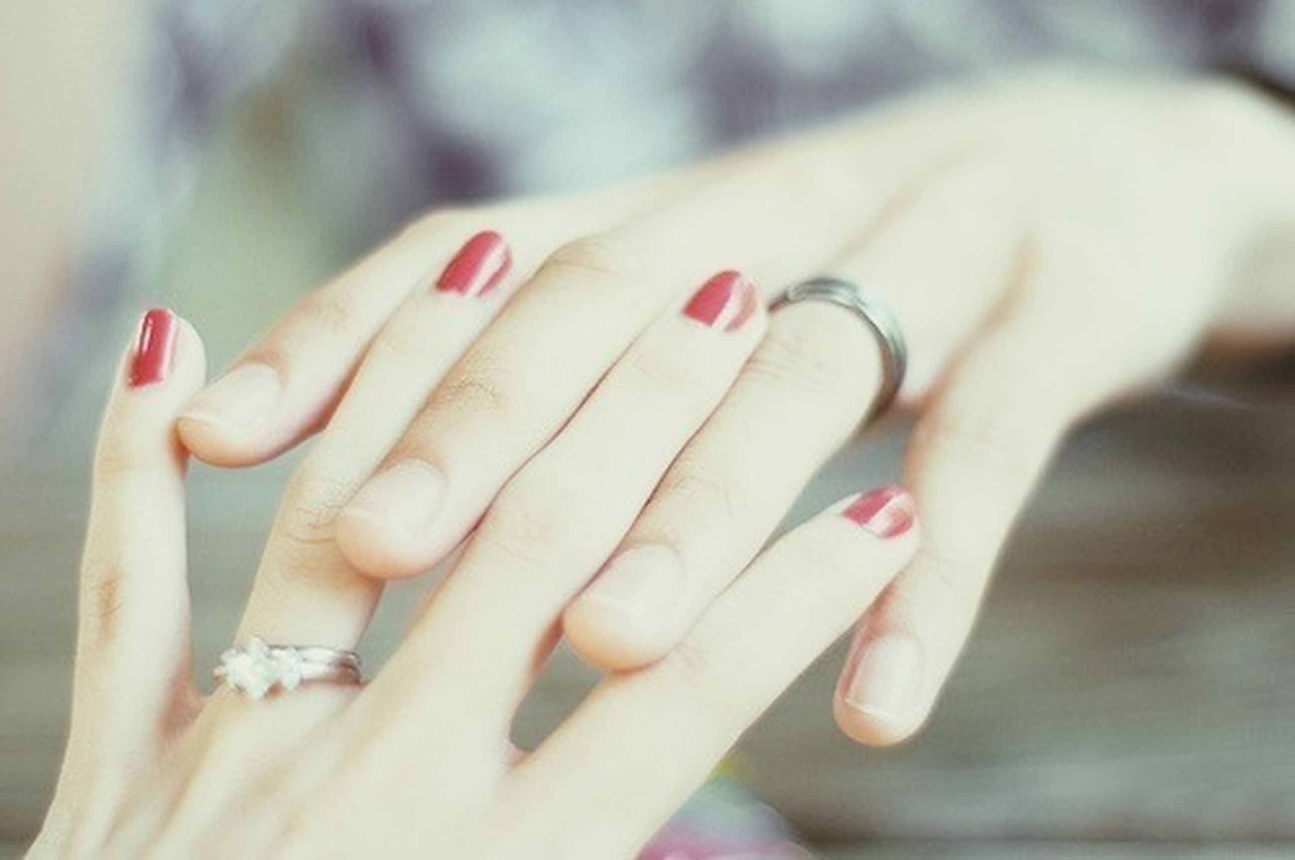 person, human finger, part of, holding, cropped, focus on foreground, close-up, indoors, lifestyles, unrecognizable person, leisure activity, personal perspective, selective focus, ring, showing, nail polish