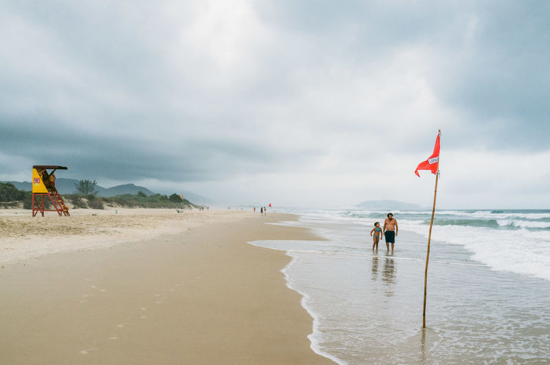 Beach Beauty In Nature Brazil Cloud Cloud - Sky Day Flag Florianópolis Horizon Over Water Leisure Activity Lifestyles Men Nature Outdoors Real People Sand Scenics Sea Shore Sky Summer Tranquil Scene Tranquility Vacations Water