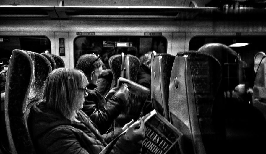Close-up of people in train