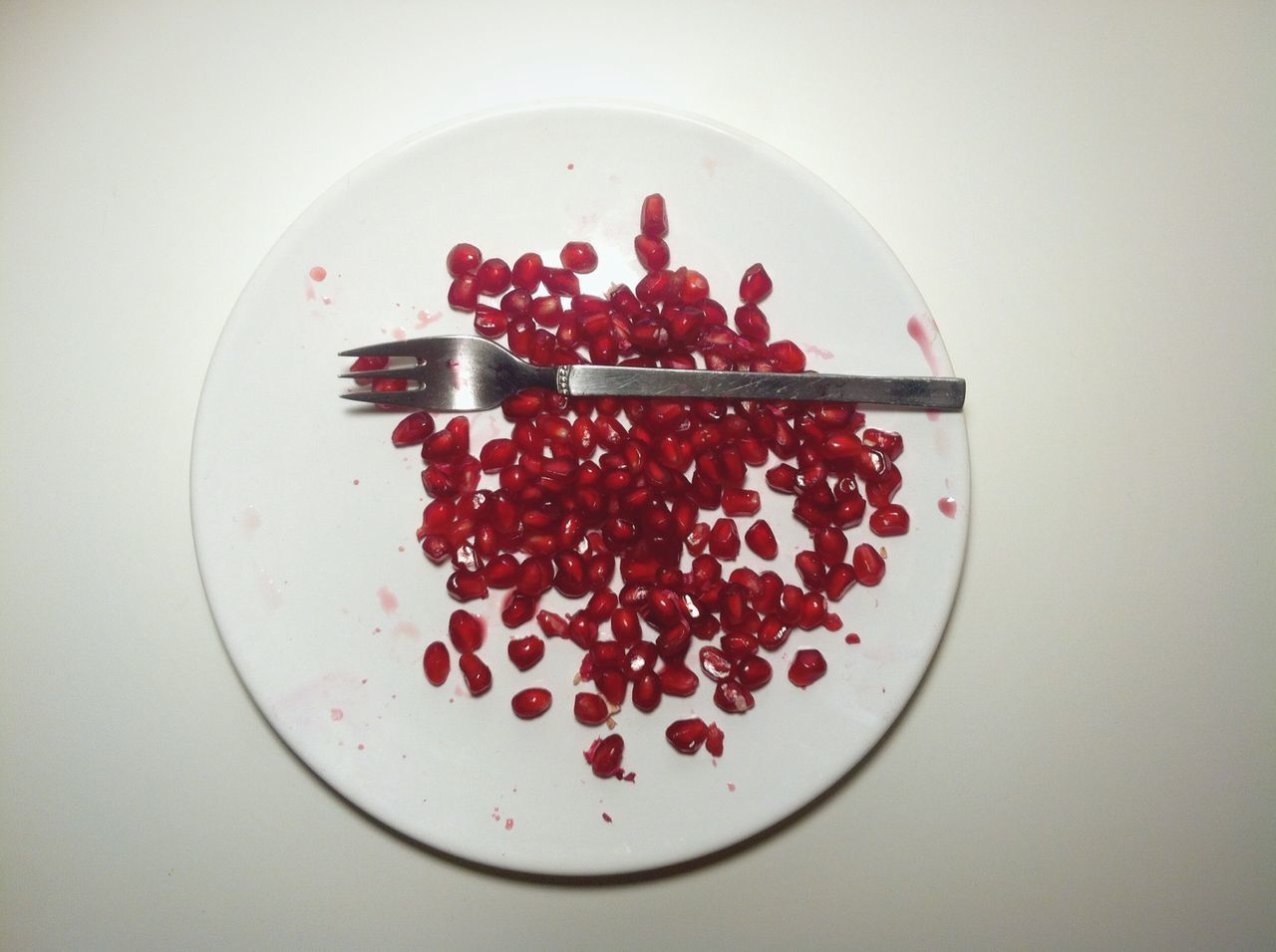 red, food and drink, studio shot, freshness, fruit, food, plate, sweet food, white background, no people, close-up, indoors, high angle view, indulgence, healthy eating, pomegranate seed, pomegranate, ready-to-eat, day