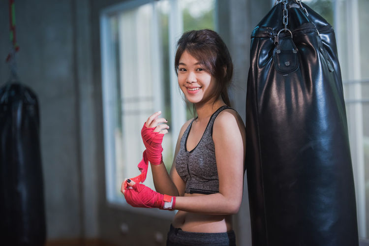 Portrait of smiling female boxer