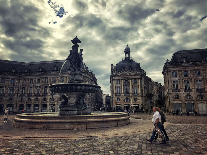 Statue of building against cloudy sky