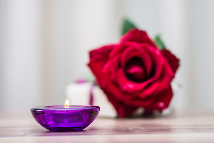 Aromatherapy candles and rose in the spa