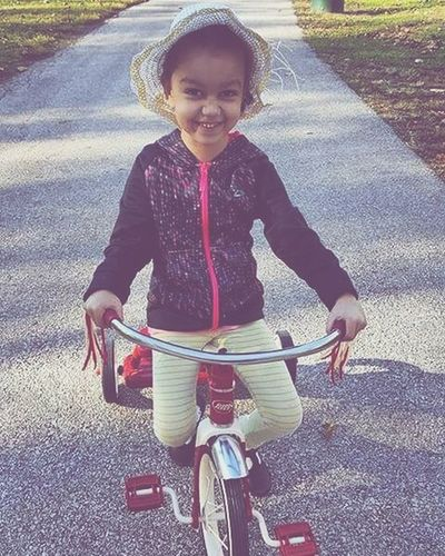 Classic Child Childhood Happiness Cycling Smiling Cheerful Bicycle Looking At Camera Outdoors Fun Sunlight Day Riding