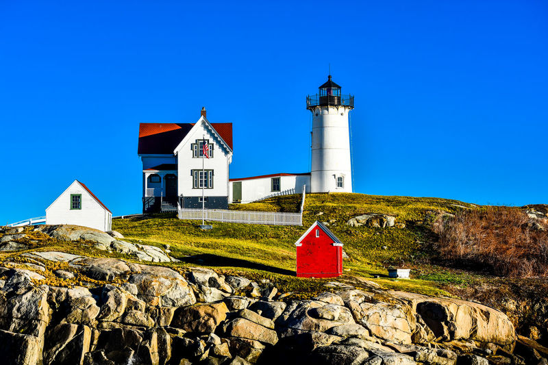 Nubble Lighthouse, Cape Nedick, Maine Lighthouse Maine New England  New England Coastal Town Architecture Blue Building Exterior Cape Nedic Clear Sky Day Grass Guidance House Lighthouse Nature New England Summer No People Outdoors Sky