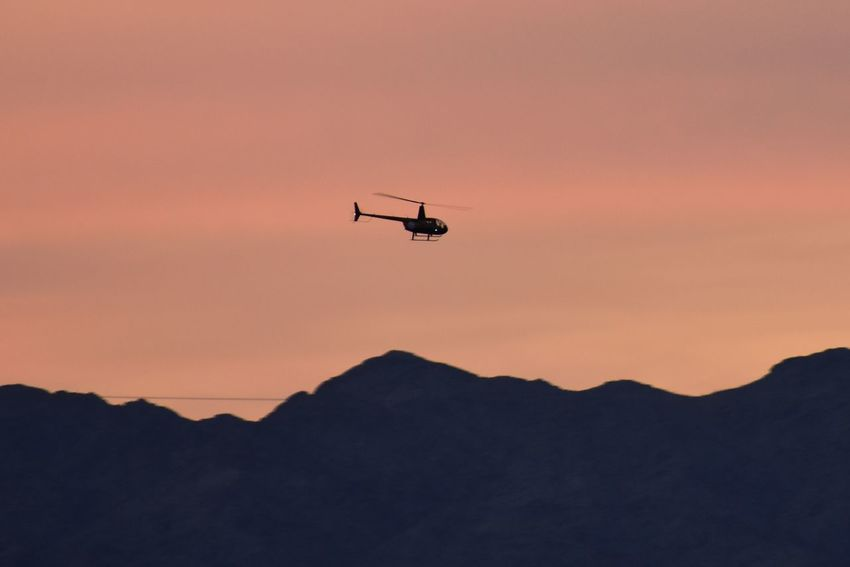 Helicopter at sunset EyeEm Selects Helicopter Flying Sunset Mountain Transportation Silhouette Air Vehicle Outdoors Technology Sky