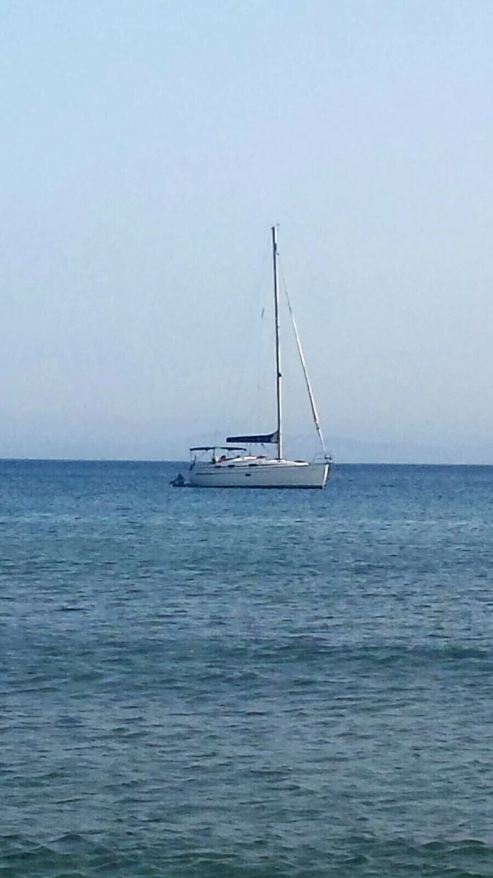 sea, water, horizon over water, nature, tranquility, beauty in nature, tranquil scene, nautical vessel, transportation, no people, scenics, outdoors, day, waterfront, mode of transport, sailboat, sky, clear sky, sailing, mast