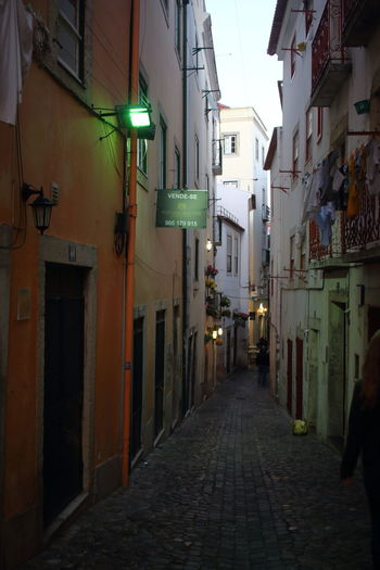 Streets Of Lisbon Alfama Lisbon - Portugal Lissabon, Portugal EyeEm City Photography Building Exterior Architecture Built Structure City The Way Forward Direction Street Residential District Building Illuminated Lighting Equipment Narrow Incidental People Footpath Alley Diminishing Perspective Cobblestone Outdoors City Life Real People Electric Lamp
