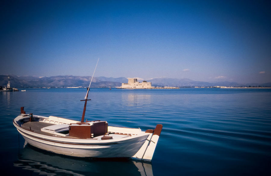 Calm winter afternoon with fantastic lighting and the old castle in the background. Boat Greece Journey Nafplion Rippled Sea Voyage Waterfront Landscape Landscape_photography Seascape On A Boat