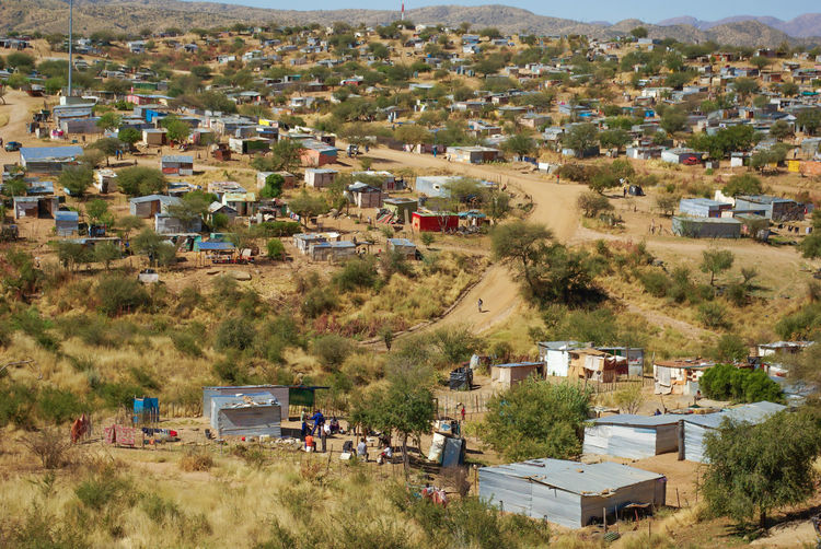 Settled Namibia Architecture Building Building Exterior Built Structure City Community Day Environment High Angle View House Land Land Vehicle Landscape Mode Of Transportation Motor Vehicle Nature Outdoors Plant Residential District Settlement Slum Transportation Tree Windhoek