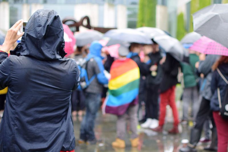 Rear view of people in rain