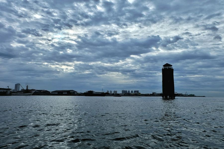 Lighthouse Tower Port Cloud - Sky Sky Water Day Outdoors No People Cityscape EyeEmNewHere First Eyeem Photo Silhouette Sunda Kelapa Port EyeEm Best Shots EyeEm Gallery