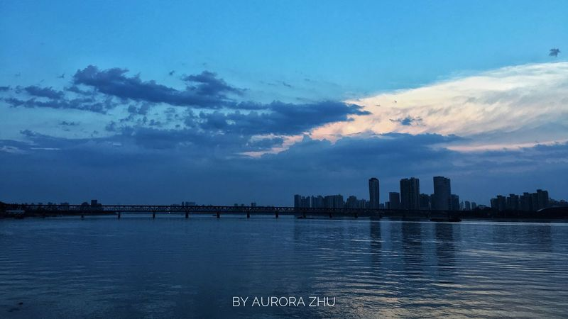 The Calm Qiantang River Sky City Water Cityscape River Urban Skyline Sunset Outdoors No People River View Calm Qiantang River Hangzhou,China