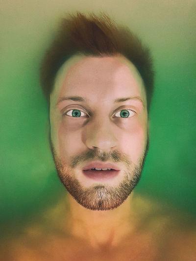Close-up portrait of man in bathtub