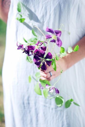 Love Summertime Sunlight Bouquet Bouquet Of Flowers Bridal Bride Clematis Day Flower Flower Arrangement Holding Lifestyles One Person Outdoors Purple Purple Flower Real People Simple Women