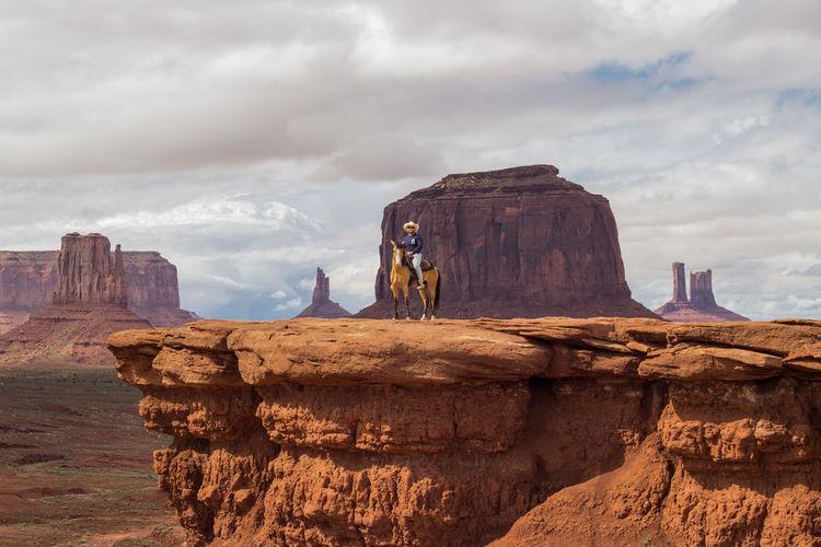 View of man riding horse against landscape