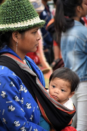 Mother watching with her baby in Central Vietnam Adult Crowd Cultures Day Human Body Part Lifestyles Meo Montagnard Mother With Baby Mountain People Vietnam Outdoors People Portrait Vietnam Vietnam Highlands Young Adult