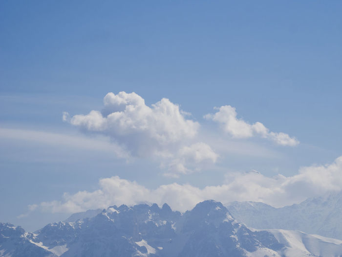 Scenic view of mountains against sky in winter