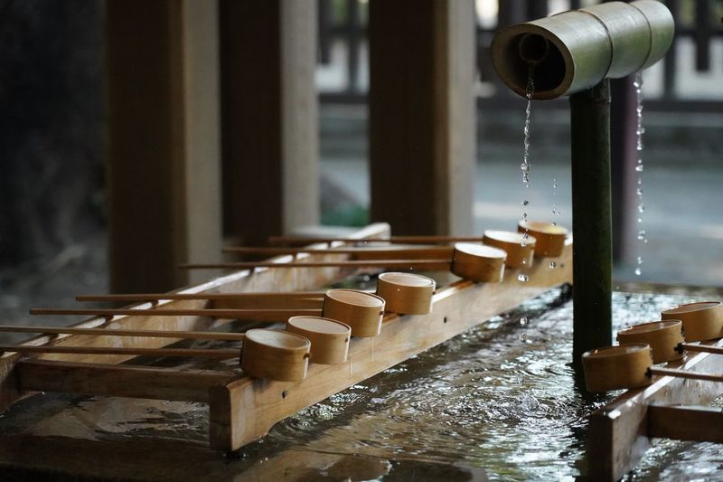 Chozu - Purify the body and spirit before entering the shrines Shrine Shinto Shrine Purify Purify Water Shintoism Ladle Dipper Japan ASIA Culture Tradition Traditional Water Focus On Foreground No People Close-up Motion Wood - Material Fountain Belief Bamboo - Material