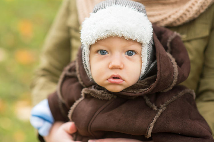 Autumn Family Fashion Holidays Snuggles Snuggling Baby Babyhood Childhood Close-up Cute Day Fall Focus On Foreground Hood - Clothing Hooded Shirt Jacket Knit Hat Nature One Person Outdoors Parenthood Real People Warm Clothes Warm Clothing