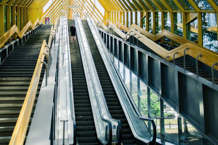 escalator and stairs Architecture Escalator Staircase Steps And Staircases Built Structure Modern Railing Convenience Real People Transportation Technology Indoors  Connection Low Angle View Men Metal Motion The Way Forward Day Moving Walkway  The Street Photographer - 2019 EyeEm Awards The Architect - 2019 EyeEm Awards