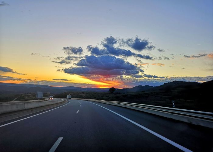 Highway against sky during sunset
