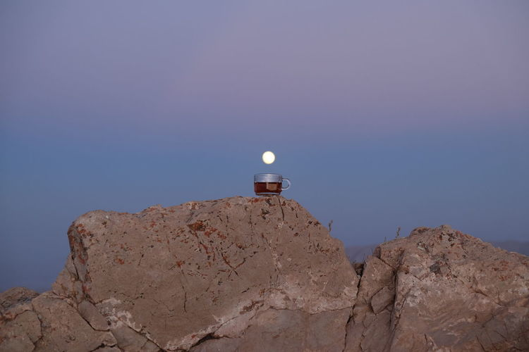 tea time in Kerman Tea Architecture Astronomy Blue Copy Space Direction Guidance Iran Low Angle View Moon Mountain Nature No People Outdoors Rock Rock - Object Scenics - Nature Sky Solid Time Tower