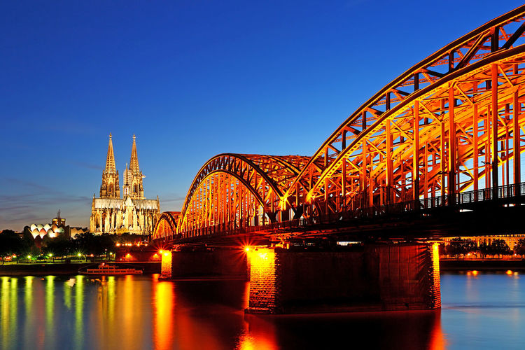 Beautiful night with hohenzollern bridge and cathedral in Cologne, Germany Architecture Built Structure Water Bridge - Man Made Structure Bridge Connection River Travel Destinations Illuminated Transportation Sky Building Exterior Nature City Reflection No People Clear Sky Tourism Outdoors Hohenzollern  Hohenzollernbridge Germany Cologne Metropolis Twilight Sky Carnival Gothic Architecture Reflection In Water Europe European  European Architecture Rhine River Train Blue