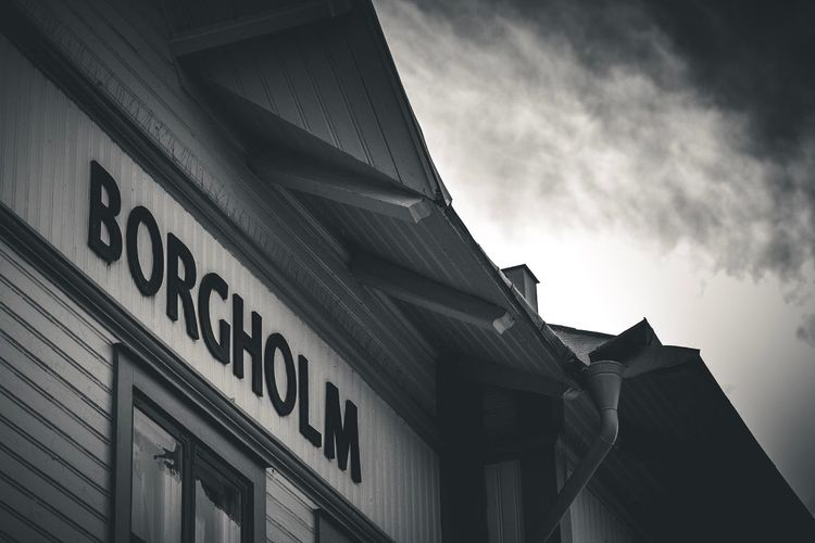 Borgholm   Low Angle View Text Architecture Building Exterior Western Script Communication Built Structure Non-western Script Sky Information Capital Letter Cloud Information Sign Day Outdoors High Section Cloud - Sky Façade City Life EyeEm Masterclass Eye4photography  EyeEm Gallery EyeEm Best Shots Blackandwhite Borgholm