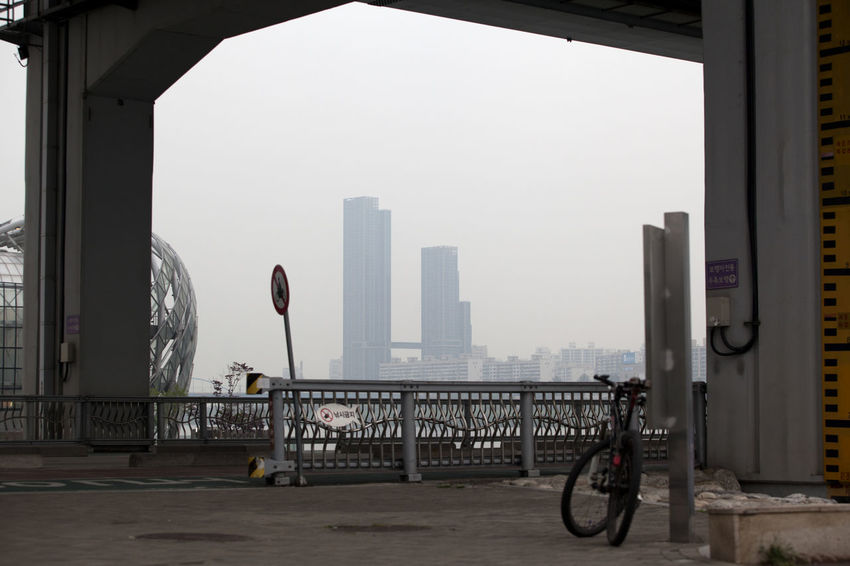 Alone Architecture Banpo Hangang Park Banpodaegyo Bicycle Building Built Structure City City Life Cityscape Day Frame In Frame Jamsugyo Land Vehicle Mode Of Transport Modern Parked Parking Riverside Sky Stationary Travel Destinations Under The Bridge Waiting