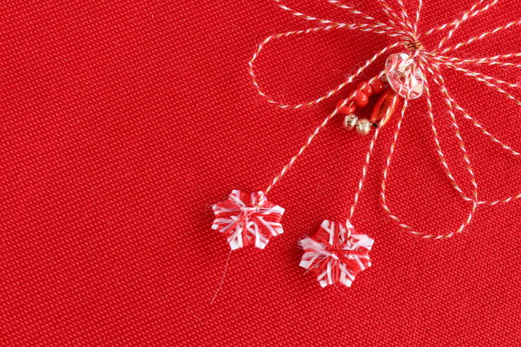 Directly above shot of christmas decoration on red textile