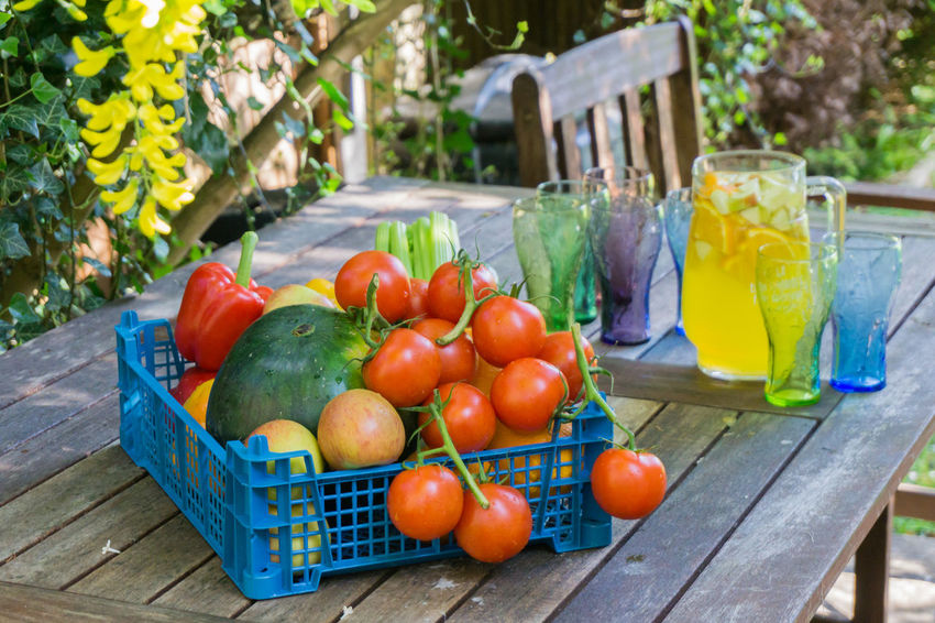 Basket of Fruit & Vegetables Baskets Of Food Cellary Cucumbers Day Freshness Fruit & Vegetable Healthy Eating Melon No People Outdoors Photograpghy  Peppers And Onions Red Color Summertime Tomatoes Up Close Water Yellow Flower